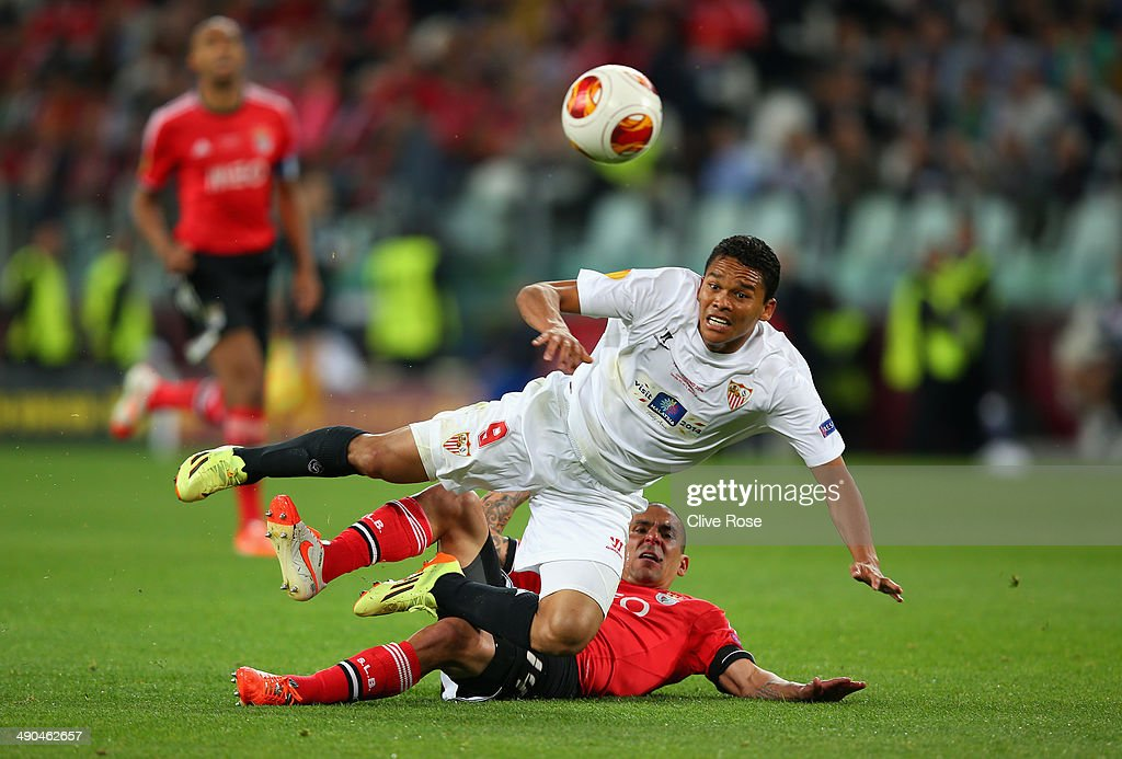 Carlos Bacca of Sevilla is tackled by Maximiliano Pereira of Benfica during the UEFA Europa League Final match between Sevilla FC and SL Benfica at...