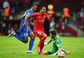 Carlos Bacca of Sevilla rounds goalkeeper Denys Boyko of Dnipro on the way to scoring his team's second goal during the UEFA Europa League Final...