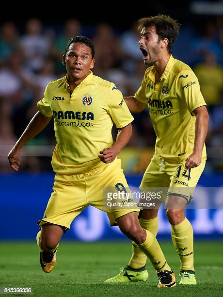 Carlos Bacca of Villarreal celebrates with Manuel Trigueros of Villarreal after scoring the first goal during the La Liga match between Villarreal CF...