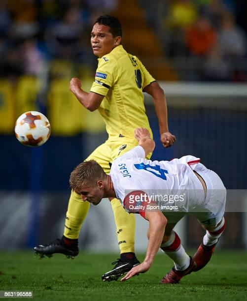 Carlos Bacca of Villarreal competes for the ball with Jakub Jugas of Slavia Praha during the UEFA Europa League group A match between Villarreal CF...