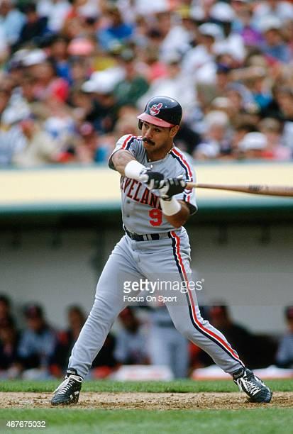 Carlos Baerga of the Cleveland Indians bats against the Oakland Athletics during an Major League Baseball game circa 1990 at the OaklandAlameda...