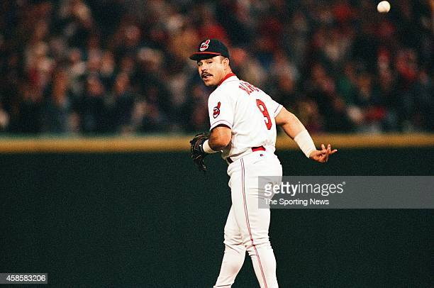 Carlos Baerga of the Cleveland Indians tosses the ball against the Texas Rangers at Progressive Field on May 17 1996 in Cleveland Ohio
