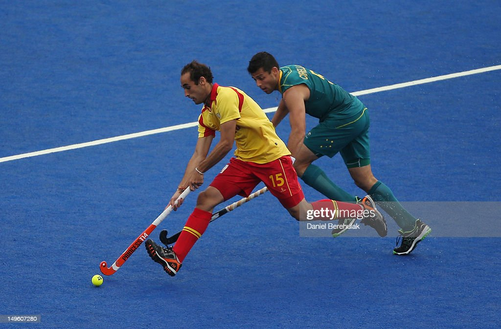 Carlos Ballbe of Spain is challenged by Christopher Ciriello of Australia during the Men's preliminary Hockey match on day 5 of the London 2012 Olympic Games at Riverbank Arena on August 1, 2012 in London, England.