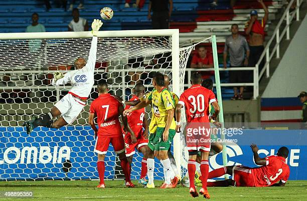 Carlos Bejarano goalkeeper of America de Cali dives to stop a shot during a match between America de Cali and Real Cartagena as part of fifth round...