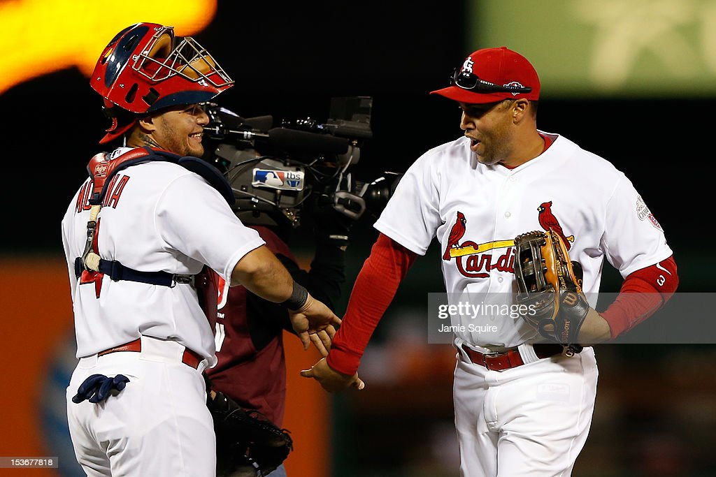 <a gi-track='captionPersonalityLinkClicked' href=/galleries/search?phrase=Carlos+Beltran&family=editorial&specificpeople=167108 ng-click='$event.stopPropagation()'>Carlos Beltran</a> #3 and <a gi-track='captionPersonalityLinkClicked' href=/galleries/search?phrase=Yadier+Molina&family=editorial&specificpeople=172002 ng-click='$event.stopPropagation()'>Yadier Molina</a> #4 of the St. Louis Cardinals celebrate after the Cardinals defeat the Washington Nationals 12-4 in Game Two of the National League Division Series at Busch Stadium on October 8, 2012 in St Louis, Missouri.