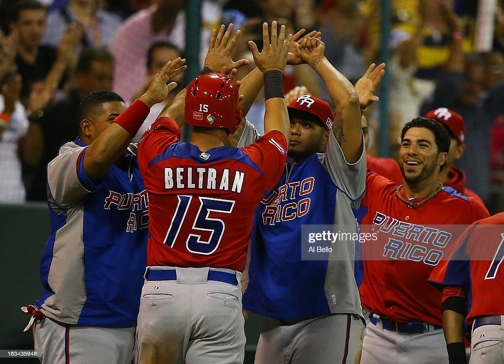 <a gi-track='captionPersonalityLinkClicked' href=/galleries/search?phrase=Carlos+Beltran&family=editorial&specificpeople=167108 ng-click='$event.stopPropagation()'>Carlos Beltran</a> #15 of Puerto Rico celebrates scoring against Venezuela during the first round of the World Baseball Classic at Hiram Bithorn Stadium on March 9, 2013 in San Juan, Puerto Rico.