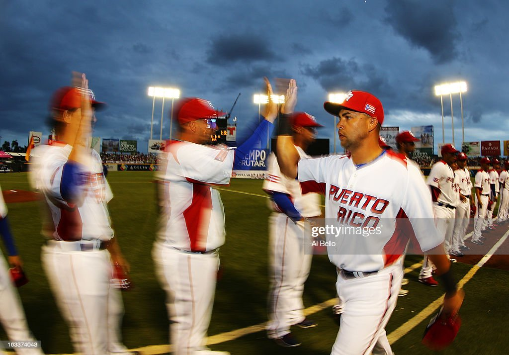 Carlos Beltran #15 of Puerto Rico greets his teamates before the game against Spain during the first round of the World Baseball Classic at Hiram Bithorn Stadium on March 8, 2013 in San Juan, Puerto Rico.