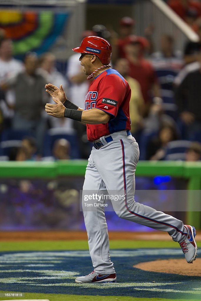 Carlos Beltran #15 of Team Puerto Rico celebrates as he crosses the plate to score in the top of the sixth inning of Pool 2, Game 4 against Team USA in the second round of the 2013 World Baseball Classic on Friday, March 15, 2013 at Marlins Park in Miami, Florida.