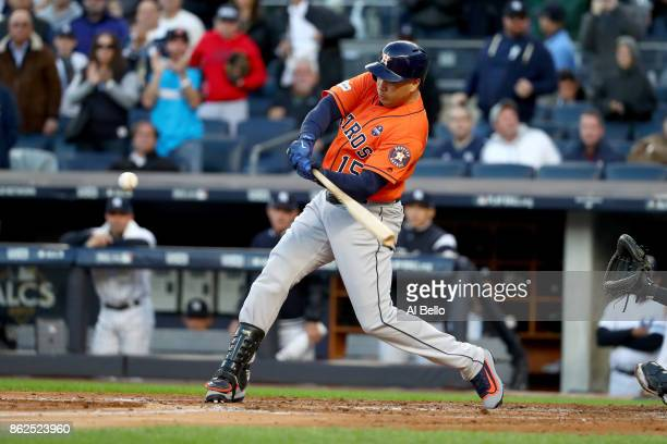 Carlos Beltran of the Houston Astros hits a double off Sonny Gray of the New York Yankees during the second inning in Game Four of the American...