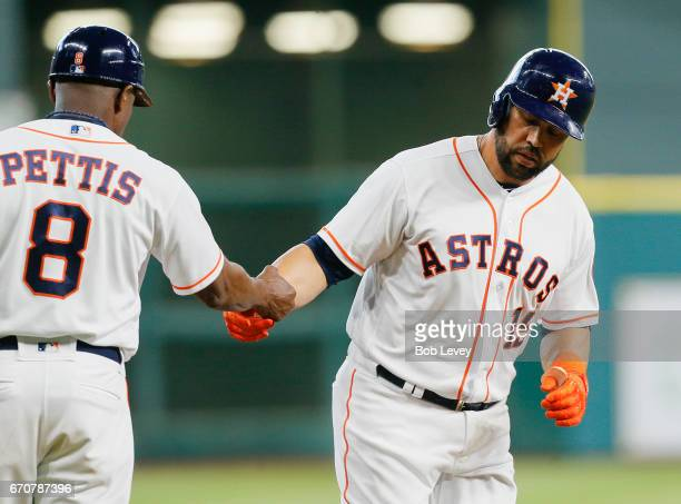 Carlos Beltran of the Houston Astros hits a home run in the first inning against the Los Angeles Angels of Anaheim at Minute Maid Park on April 20...