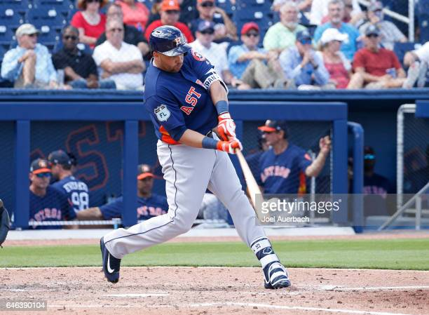 Carlos Beltran of the Houston Astros hits a two run home run against the Washington Nationals in the fourth inning during a spring training game at...