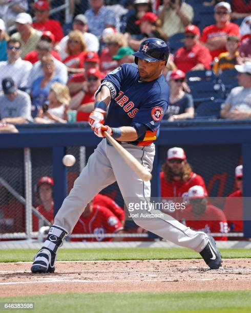 Carlos Beltran of the Houston Astros hits the ball against the Washington Nationals in the second inning during a spring training game at The...