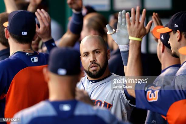 Carlos Beltran of the Houston Astros is congratulated by teammates in the dugout after hitting a tworun home run during the 4th inning of the game...