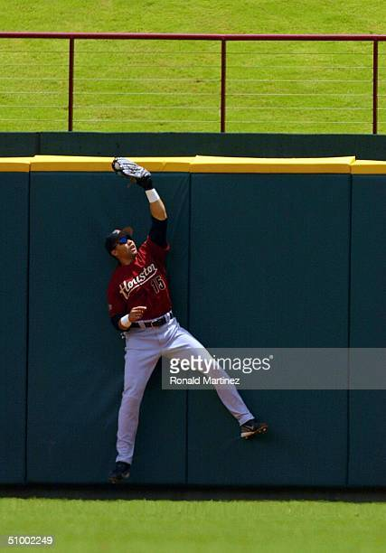 Carlos Beltran of the Houston Astros makes the out at the wall against the Texas Rangers at Ameriquest Field in Arlington on June 27 2004 in...