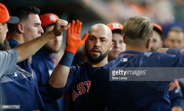Carlos Beltran of the Houston Astros receives high fives after hitting a home run in the second inning against the Cleveland Indians at Minute Maid...