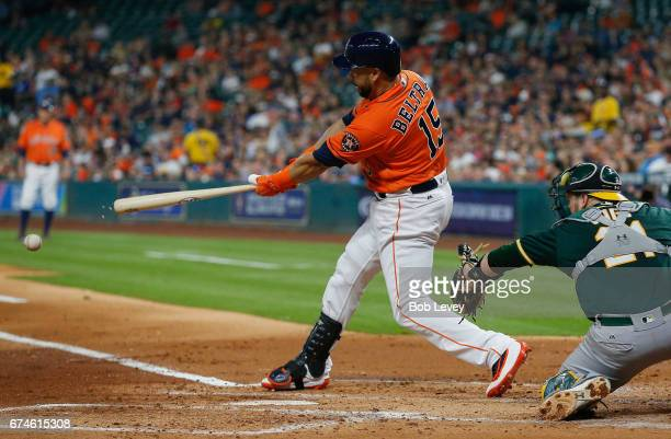 Carlos Beltran of the Houston Astros singles in the first inning against the Oakland Athletics at Minute Maid Park on April 28 2017 in Houston Texas
