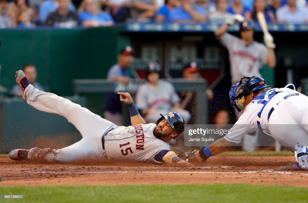 Carlos Beltran #15 of the Houston Astros slides safely into home plate to score avoiding the tag of Salvador Perez #13 of the Kansas City Royals during the 3rd inning of the game at Kauffman Stadium on June 6, 2017 in Kansas City, Missouri.