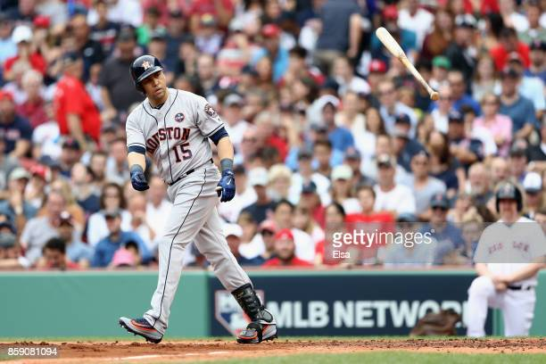 Carlos Beltran of the Houston Astros tosses his bat as he is walked in the second inning against the Boston Red Sox during game three of the American...