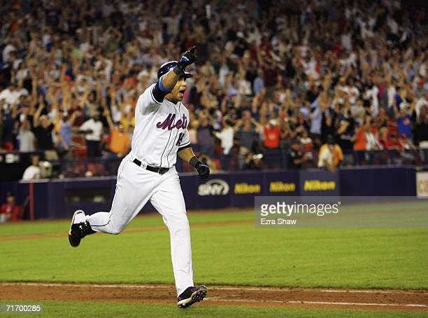 Carlos Beltran of the New York Mets celebrates as he runs up the first base line after he hit a two run walk off home run to beat the St Louis...
