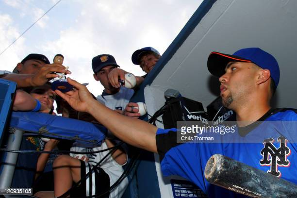 Carlos Beltran of the New York Mets signs autographs before the game against the New York Yankees at Yankee Stadium on June 30 2006 in Bronx New York