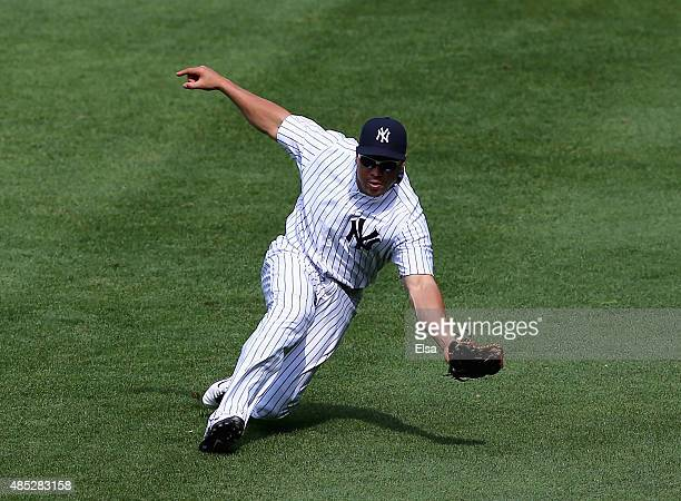 Carlos Beltran of the New York Yankees catches a hit by Jed Lowrie of the Houston Astros in the seventh inning on August 26 2015 at Yankee Stadium in...