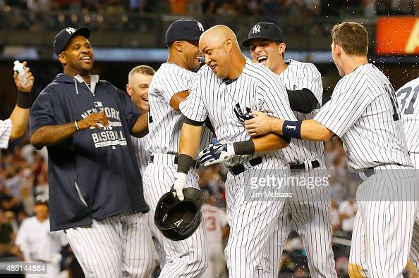 Carlos Beltran of the New York Yankees celebrates his ninth inning game winning sacrifice fly against the Houston Astros with his teammates at Yankee...