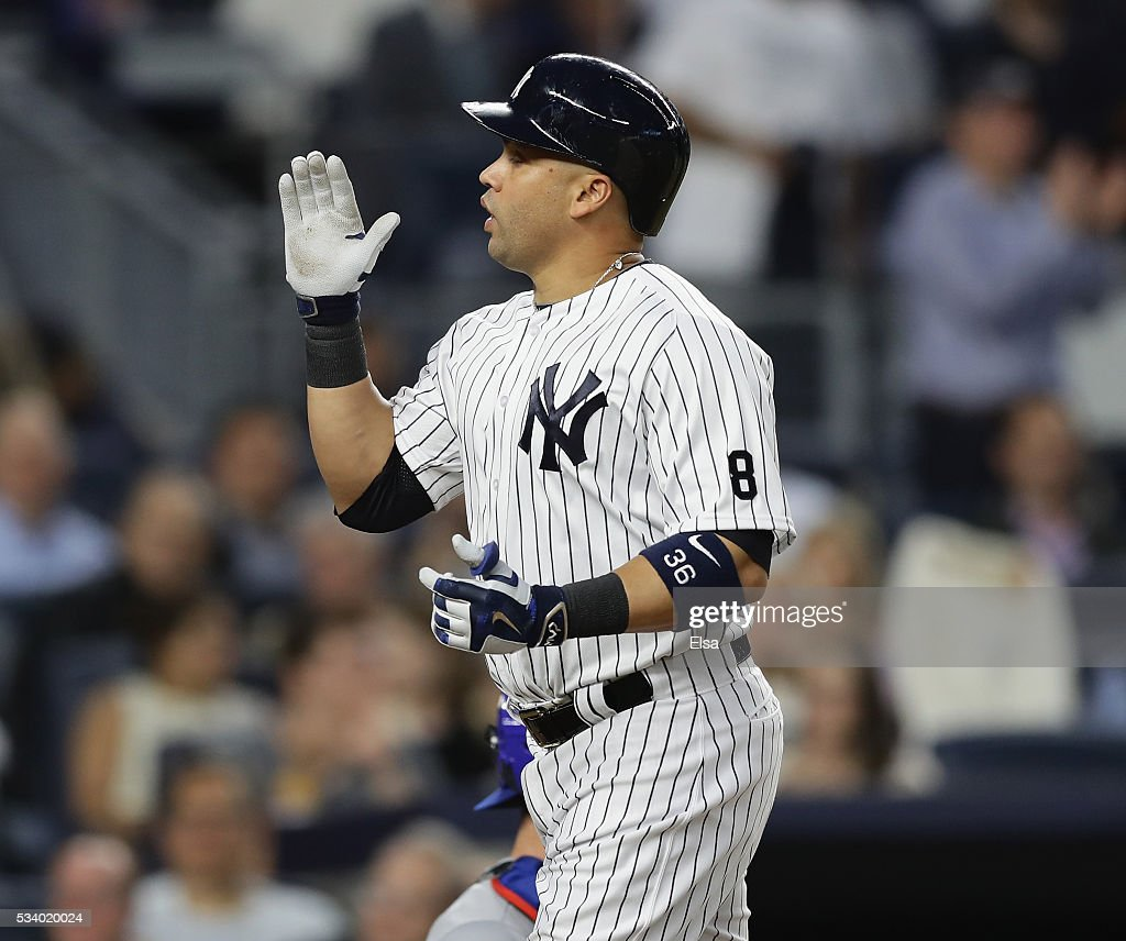 <a gi-track='captionPersonalityLinkClicked' href=/galleries/search?phrase=Carlos+Beltran&family=editorial&specificpeople=167108 ng-click='$event.stopPropagation()'>Carlos Beltran</a> #36 of the New York Yankees celebrates his solo home run in the fourth inning against the Toronto Blue Jays at Yankee Stadium on May 24, 2016 in the Bronx borough of New York City.