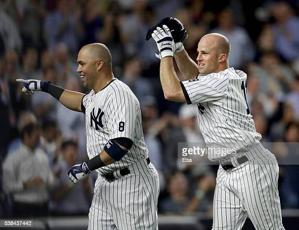 Carlos Beltran of the New York Yankees celebrates his three run home run with teammate Brett Gardner in the eighth inning against the Los Angeles...
