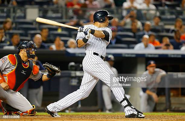 Carlos Beltran of the New York Yankees follows through on his ninth inning game winning sacrifice fly against the Houston Astros at Yankee Stadium on...