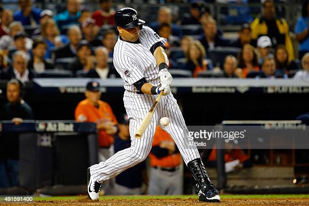 Carlos Beltran of the New York Yankees hits a single to center in the sixth inning against Dallas Keuchel of the Houston Astros during the American...