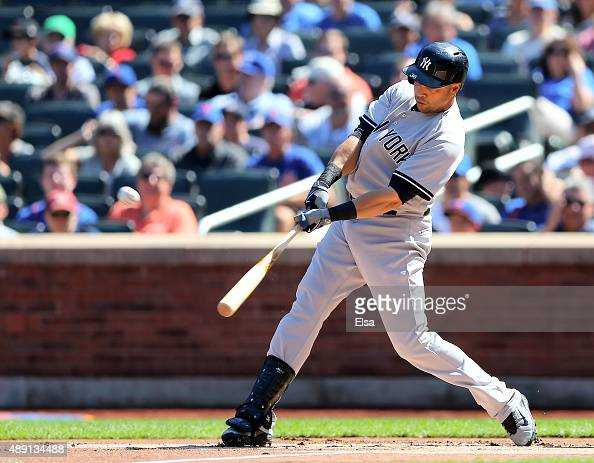 Carlos Beltran of the New York Yankees hits a three run home run in the first inning against the New York Mets during interleague play on September...