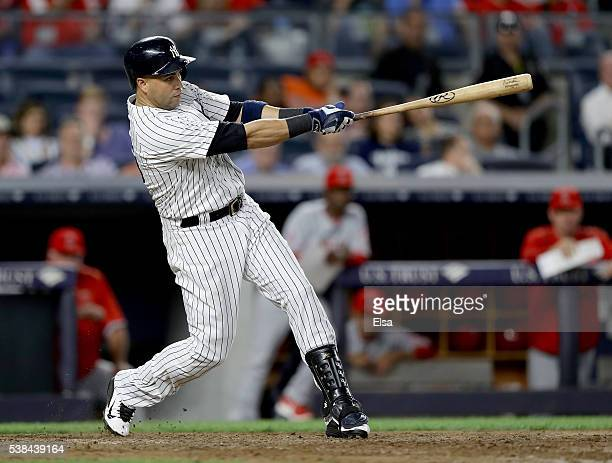 Carlos Beltran of the New York Yankees hits a three run home run in the eighth inning against the Los Angeles Angels at Yankee Stadium on June 6 2016...