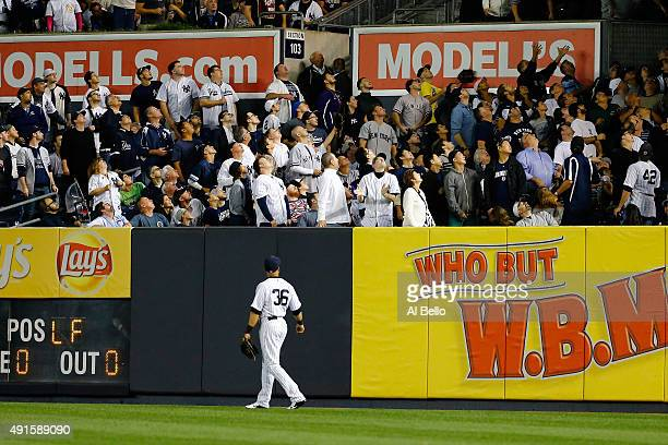 Carlos Beltran of the New York Yankees looks on after Colby Rasmus of the Houston Astros hit a solo home run against Masahiro Tanaka of the New York...