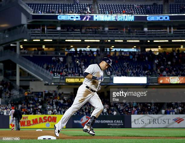 Carlos Beltran of the New York Yankees rounds third base after he hit a two run home run in the seventh inning against the Los Angeles Angels at...