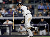 Carlos Beltran of the New York Yankees watches his two run home run as he heads for first base in the seventh inning against the Los Angeles Angels...