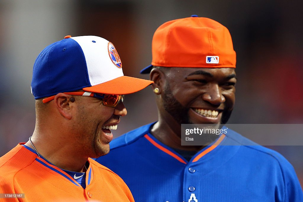 Carlos Beltran (L) of the St. Louis Cardinals and David Ortiz of the Boston Red Sox share a laugh during the Chevrolet Home Run Derby on July 15, 2013 at Citi Field in the Flushing neighborhood of the Queens borough of New York City.