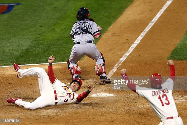 Carlos Beltran of the St Louis Cardinals and Matt Carpenter celebrate as they score on a double by Matt Holliday in the seventh inning as Jarrod...