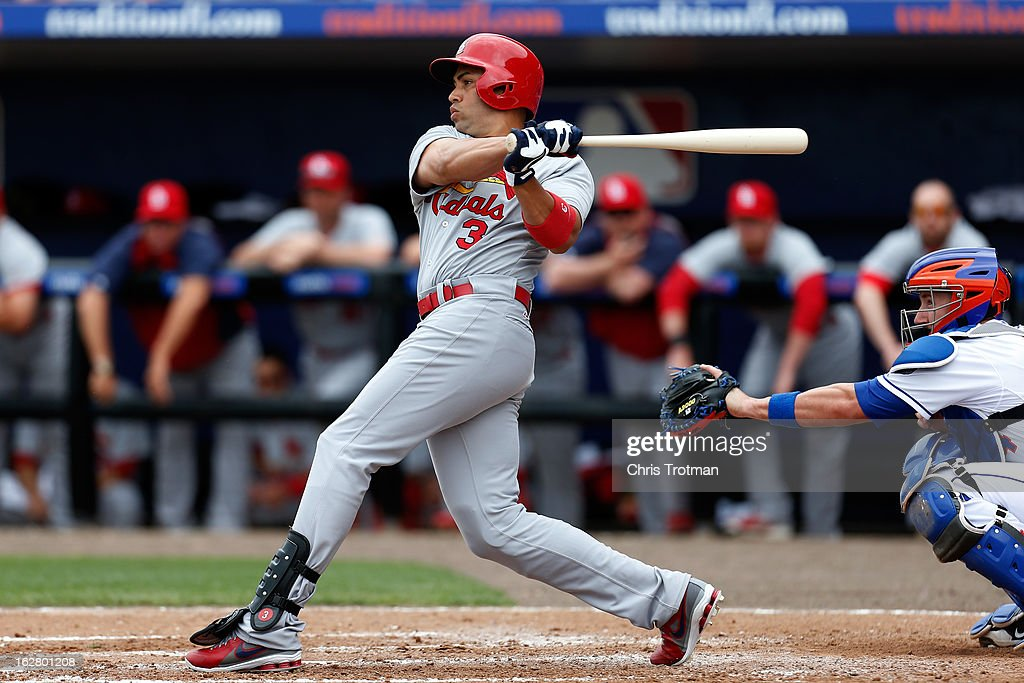 <a gi-track='captionPersonalityLinkClicked' href=/galleries/search?phrase=Carlos+Beltran&family=editorial&specificpeople=167108 ng-click='$event.stopPropagation()'>Carlos Beltran</a> #3 of the St. Louis Cardinals bats as <a gi-track='captionPersonalityLinkClicked' href=/galleries/search?phrase=John+Buck&family=editorial&specificpeople=213730 ng-click='$event.stopPropagation()'>John Buck</a> #44 of the New York Mets looks on at Tradition Field on February 27, 2013 in Port St. Lucie, Florida.