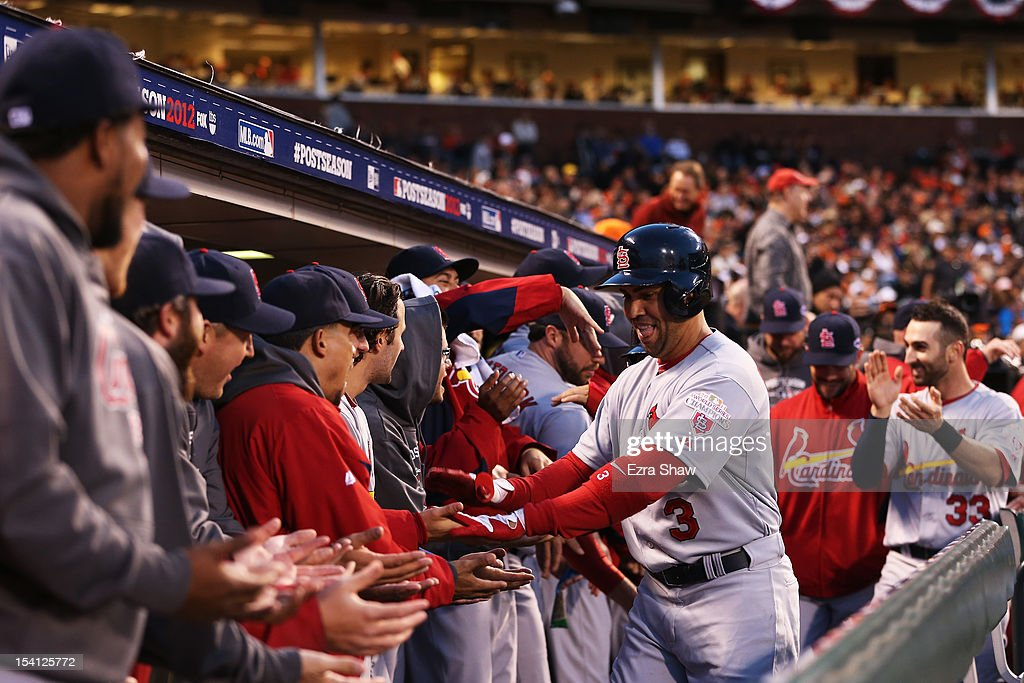 <a gi-track='captionPersonalityLinkClicked' href=/galleries/search?phrase=Carlos+Beltran&family=editorial&specificpeople=167108 ng-click='$event.stopPropagation()'>Carlos Beltran</a> #3 of the St. Louis Cardinals celebrates his two-run home run with teammates in the dugout during the fourt inning of Game One of the National League Championship Series against the San Francisco Giants at AT&T Park on October 14, 2012 in San Francisco, California.