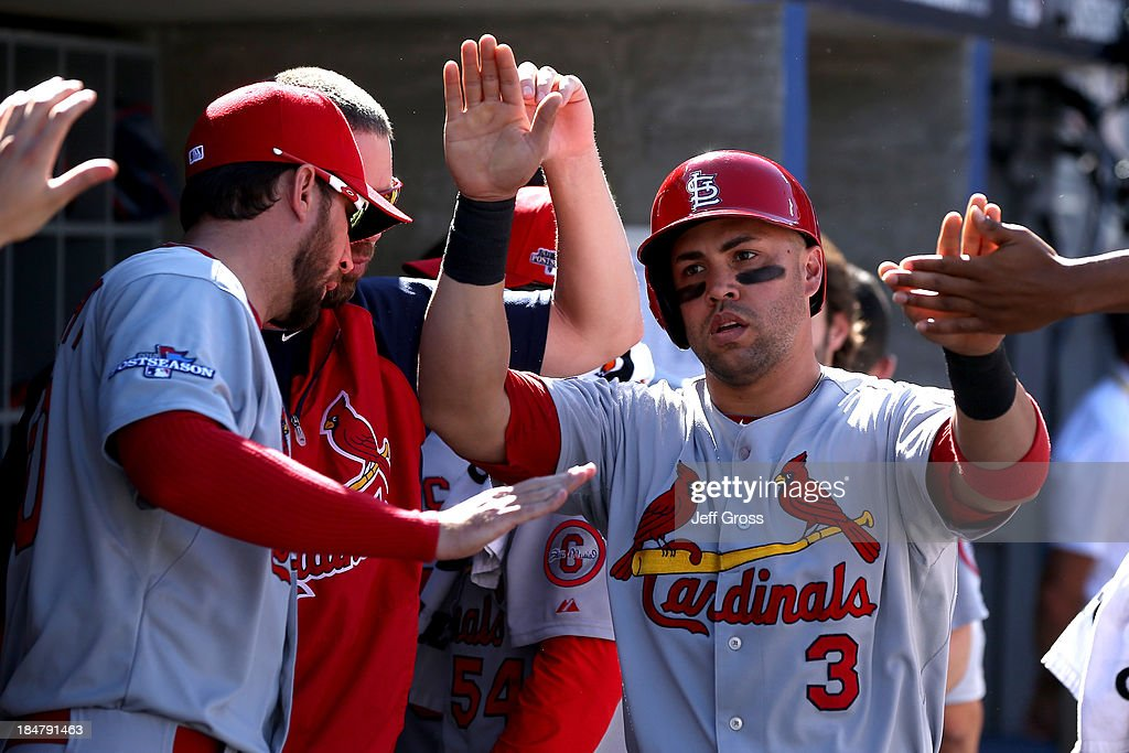 <a gi-track='captionPersonalityLinkClicked' href=/galleries/search?phrase=Carlos+Beltran&family=editorial&specificpeople=167108 ng-click='$event.stopPropagation()'>Carlos Beltran</a> #3 of the St. Louis Cardinals celebrates in the dugout after scoring a run in the third inning against the Los Angeles Dodgers in Game Five of the National League Championship Series at Dodger Stadium on October 16, 2013 in Los Angeles, California.