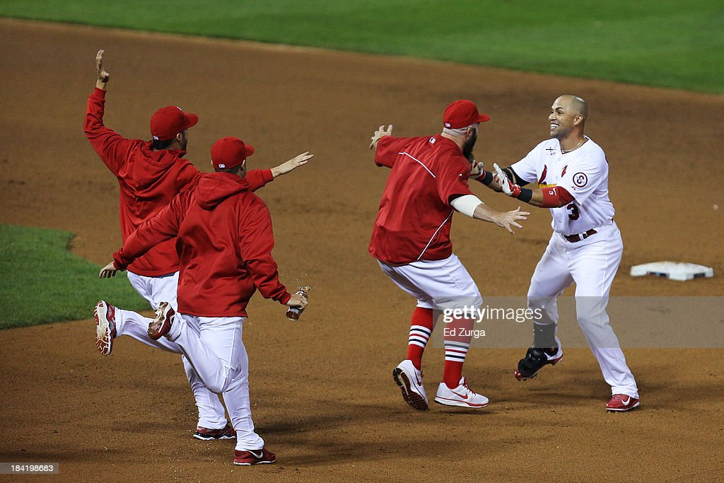 Carlos Beltran #3 of the St. Louis Cardinals celebrates their 3 to 2 win over the Los Angeles Dodgers with teammates during Game One of the National League Championship Series at Busch Stadium on October 11, 2013 in St Louis, Missouri.