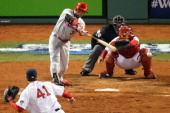 Carlos Beltran of the St Louis Cardinals hits a RBI single in the seventh inning off pitcher John Lackey of the Boston Red Sox during Game Six of the...