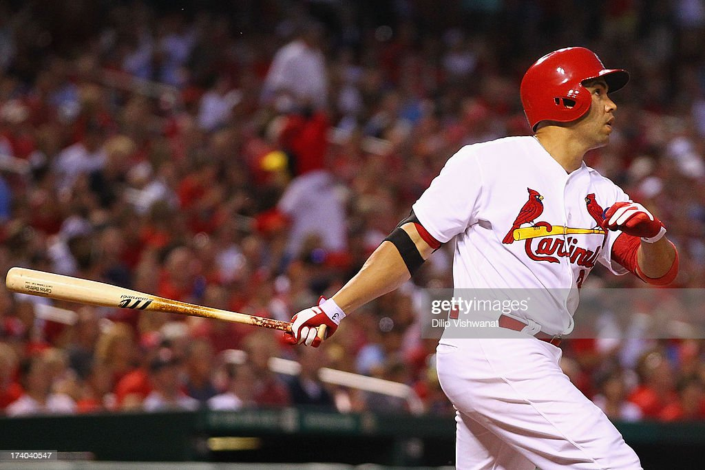 <a gi-track='captionPersonalityLinkClicked' href=/galleries/search?phrase=Carlos+Beltran&family=editorial&specificpeople=167108 ng-click='$event.stopPropagation()'>Carlos Beltran</a> #3 of the St. Louis Cardinals hits a sacrifice RBI against the San Diego Padres in the fifth inning at Busch Stadium on July 19, 2013 in St. Louis, Missouri.