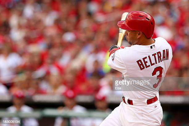 Carlos Beltran of the St Louis Cardinals hits a threerun home run in the third inning against the Pittsburgh Pirates during Game One of the National...