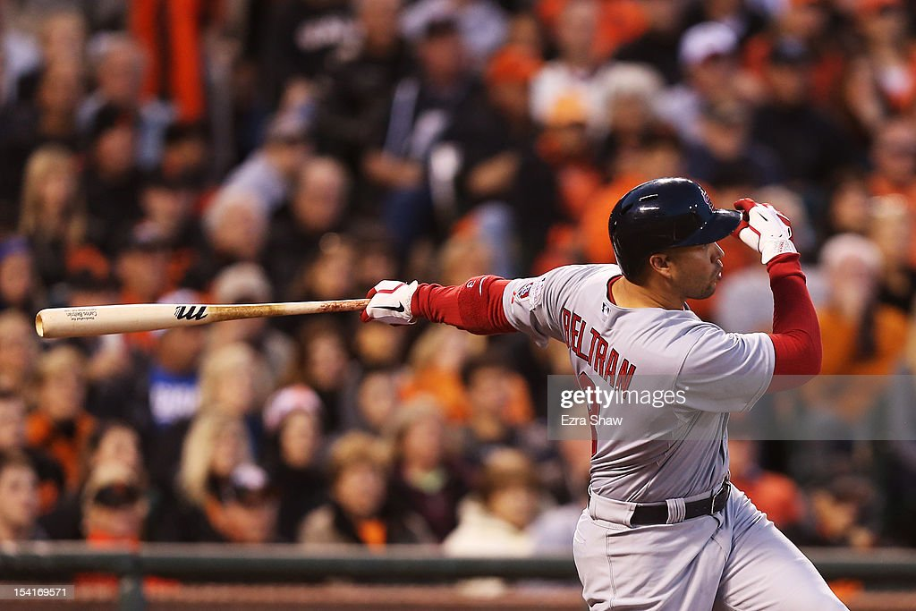 <a gi-track='captionPersonalityLinkClicked' href=/galleries/search?phrase=Carlos+Beltran&family=editorial&specificpeople=167108 ng-click='$event.stopPropagation()'>Carlos Beltran</a> #3 of the St. Louis Cardinals hits a two-run home run in the fourth inning during Game One of the National League Championship Series against the San Francisco Giants at AT&T Park on October 14, 2012 in San Francisco, California.