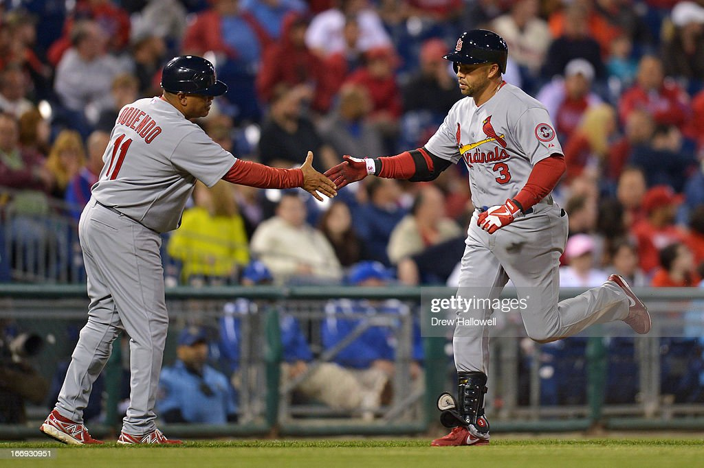 <a gi-track='captionPersonalityLinkClicked' href=/galleries/search?phrase=Carlos+Beltran&family=editorial&specificpeople=167108 ng-click='$event.stopPropagation()'>Carlos Beltran</a> #3 of the St. Louis Cardinals is congratulated by third base coach third base coach Jose Oquendo #11 on hitting a home run in the eighth inning against the Philadelphia Phillies at Citizens Bank Park on April 18, 2013 in Philadelphia, Pennsylvania. The Cardinals won 4-3.