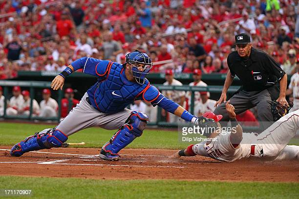 Carlos Beltran of the St Louis Cardinals scores a run against AJ Pierzynski of the Texas Rangers in the first inning at Busch Stadium on June 22 2013...