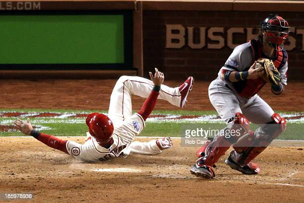 Carlos Beltran of the St Louis Cardinals slides into home to score on a two RBI double by Matt Holliday as Jarrod Saltalamacchia of the Boston Red...