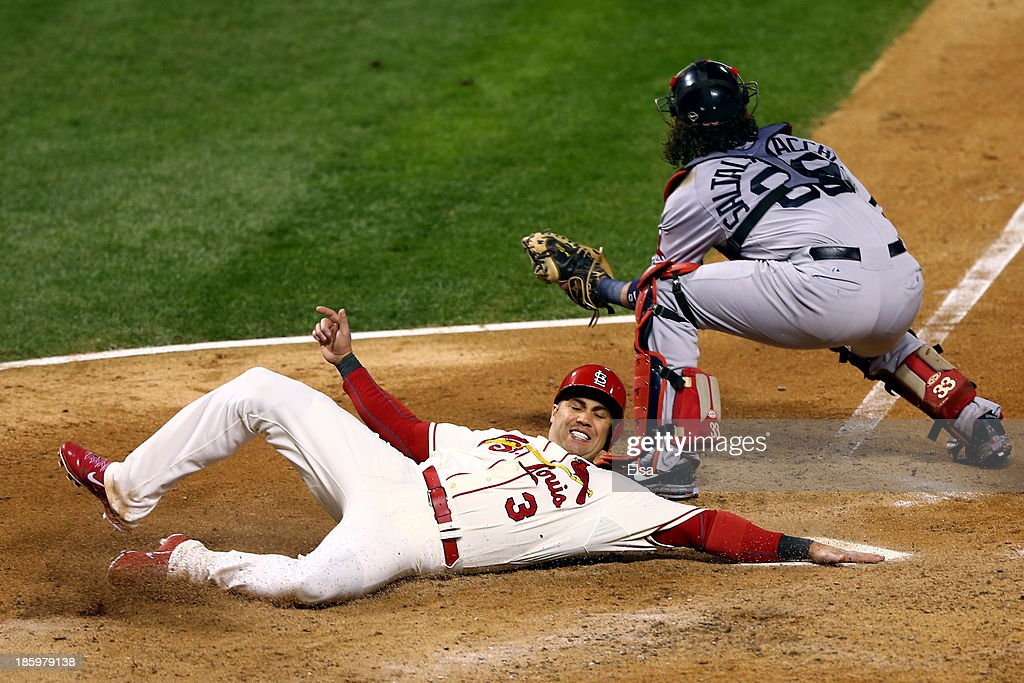 Carlos Beltran #3 of the St. Louis Cardinals slides into home to score on a two RBI double by Matt Holliday #7 as Jarrod Saltalamacchia #39 of the Boston Red Sox defends in the seventh inning against the Boston Red Sox during Game Three of the 2013 World Series at Busch Stadium on October 26, 2013 in St Louis, Missouri.