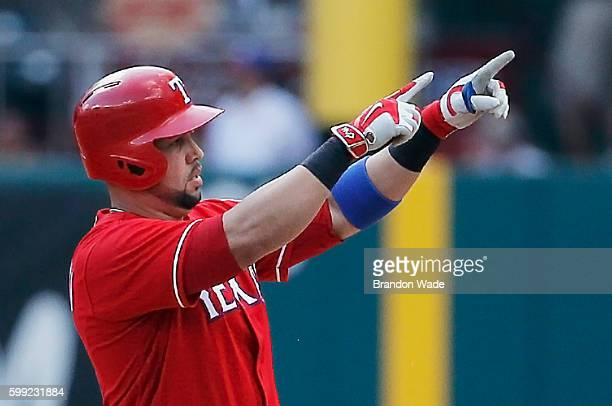 Carlos Beltran of the Texas Rangers celebrates hitting an RBI double during the fifth inning of a baseball game against the Houston Astros at Globe...